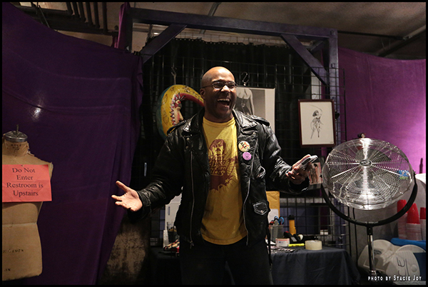 Performing an erotic reading at Purple Passion in New York City. Photo by Stacie Joy.